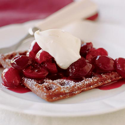 Chocolate Waffles with Poached Cherries RecipeFor a fancy breakfast or show-stopping dessert, this recipe is easier to pull together than it appears. The poached cherries that top the waffles cook in just 10 minutes. And the waffles, while they come with a long ingredient list, take only 15 minutes to prepare.