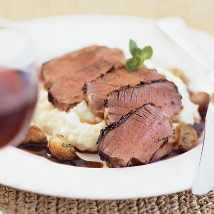 Grilled Lamb Loin with Cabernet-Mint Sauce and Garlic Mashed Potatoes RecipeShow off your culinary prowess with this chef-inspired recipe featuring tender lamb slices served over a bed of creamy mashed potatoes accompanied by a rich wine sauce.