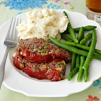 Meat Loaf RecipeThis old-fashioned meat loaf is packed with tender chopped onion and bell pepper and topped with ketchup.   Serve with mashed potatoes and green beans for a meal that will remind you of Sunday dinner at Mama's table.