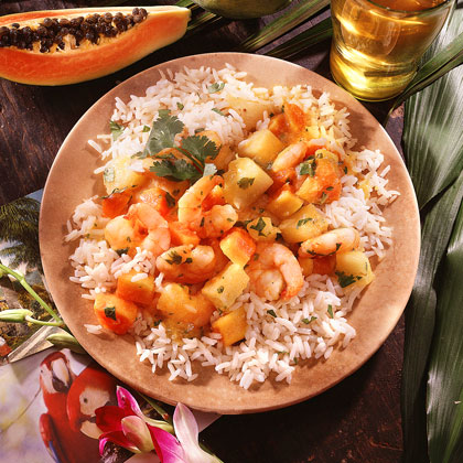 Sweet-and-Sour Shrimp in Fruit Sauce RecipeSpice up dinner with a tangy shrimp dish loaded with fresh fruit and herbs. Pineapple, papaya, and orange juice add a bright freshness to the dish and are perfectly complemented by the white wine vinegar and cilantro sauce.