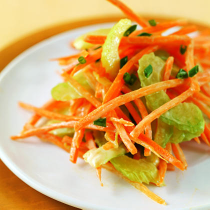 Carrot-Celery Slaw with Yogurt Dressing RecipeThe colorful combination of carrots and celery is fun, but what makes this salad so special is its light creamy dressing. Made with low-fat plain yogurt, Dijon mustard, and olive oil, it's a refreshing alternative to fat-laden mayonnaise.