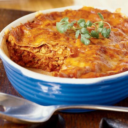 """We love this recipe! I make it exactly as stated and our family of 5 loves it. Some eat it as served. Others top it off with sour cream and salsa. It's wonderful and a great way to use ground turkey."" —Dinnertime5Turkey Enchilada Casserole Recipe"