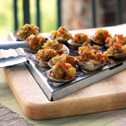 Grilled Clams with Sambuca and Italian Sausage RecipeFor a seafood starter that meat-lovers will adore, look no further. A hearty mixture of Italian sausage and breadcrumbs tops each clam; a splash of licorice-flavored liqueur really enhances the flavor. Be sure to use a vegetable or shellfish grate when grilling, or choose clams large enough to be set directly on the grill rack.