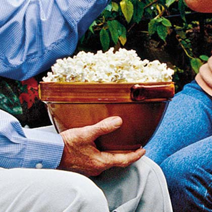 Kettle Corn RecipeBring back fond memories of childhood and state fairs with this sweet and salty treat. Use a hand-cranked popcorn popper and sprinkle with sugar and a little kosher salt, then serve and watch it disappear.