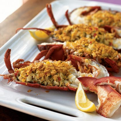 Crab-Stuffed Lobster with Citrus Vinaigrette RecipeAs long as you're spending money, why not go all out and dine on both fresh lump crabmeat and live lobsters? When you make this dish at home rather than ordering it in a restaurant, you'll still have money left for a fine bottle of Champagne.