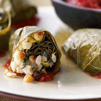 Brown Rice-Stuffed Grape Leaves in Tomato Sauce RecipeA version of Greek dolmades, this appetizer features grape leaves filled with a mixture of herbed brown rice, leek, parsley, currants, and pine nuts. The stuffed leaves are then nestled in tomato sauce and simmered until thoroughly heated.