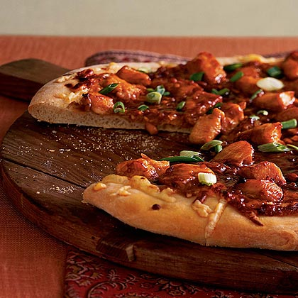 Malaysian Chicken Pizza RecipeInstead of a tomato sauce, this pizza is topped with a sweet and spicy peanut sauce. Its out-of-the ordinary Southeast Asia flavor has earned it a 5-star rating from our online reviewers.