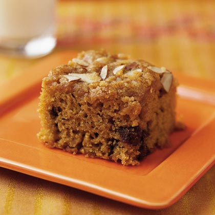 Cardamom-Date Snack Cake RecipeChopped dates and applesauce make this snack cake sweet and tender, while cardamom and cinnamon add a warm spiciness. Heart-healthy almonds are tossed with a little brown sugar and butter and sprinkled over the top of the cake for a healthy crunch.