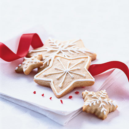 Christmas Sugar Wafers with Vanilla Icing RecipeTry a variety of cookie cutters for a beautifully festive presentation.