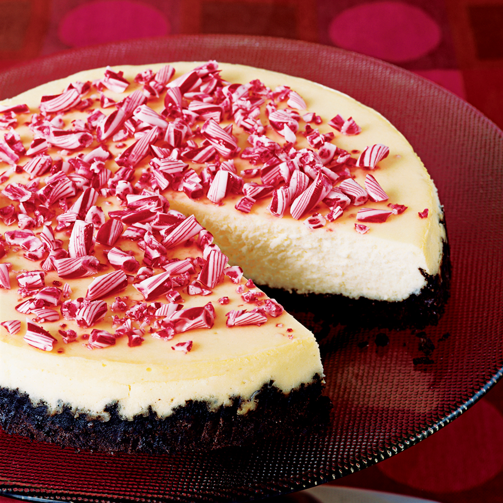 Crushed Peppermint Cheesecake RecipeThis peppermint cheesecake features a homemade Oreo cookie crust and crushed peppermint candy topping and is ideal for holiday entertaining.