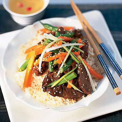 Korean Beef Rice Bowl RecipeTop rice with stir-fried beef and vegetables for a quick, Asian-inspired supper that's delicious and satisfying.
