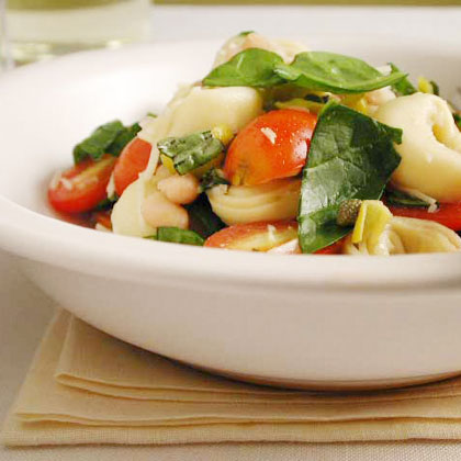 With spicy peppers, sweet cherry tomatoes, earthy beans, and lots of fresh herbs, this well-balanced meatless recipe is a meal in itself. Just serve with a glass of iced tea.Tortellini Pepperoncini Salad