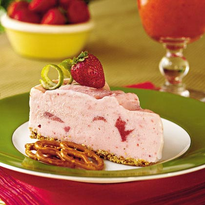 "Spiked Strawberry-Lime Ice-Cream Pie RecipeAn easy-to-make adult dessert, the crust for this frozen ""strawberry rita"" is made with crushed pretzels, butter, and sugar. And the filling? It's a mix of strawberry ice cream, fresh strawberries, limeade concentrate, orange liqueur, and tequila.This pie will soften quickly due to the alcohol content, which lowers the freezing temperature of the ice cream."