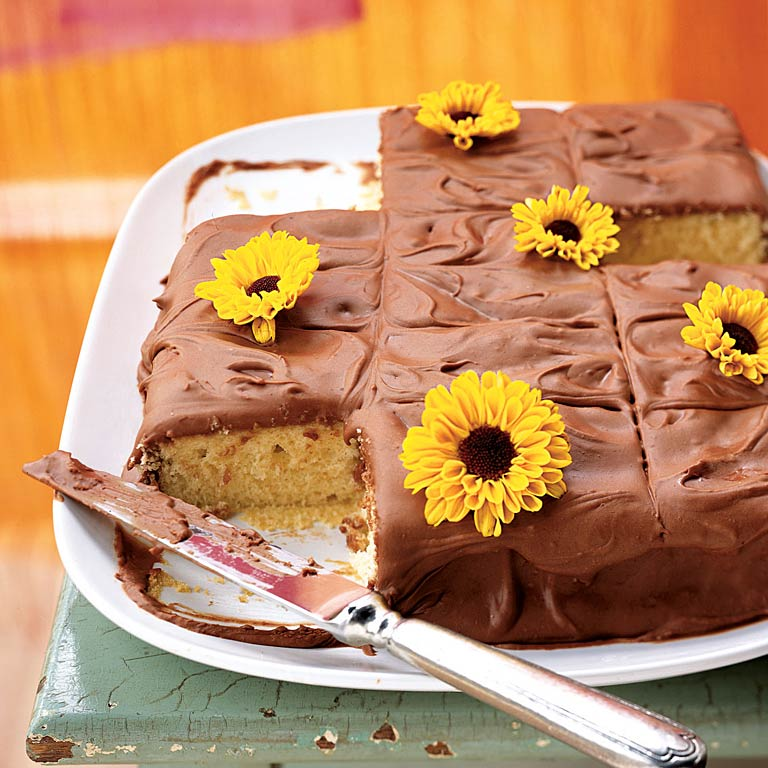 Here's a moist, buttery dessert that can make any occasion a celebration. It was a favorite with our staffers, receiving top scores for its taste. Fresh edible flowers, such as mums, make an easy, pretty decoration; most people do remove the flowers before eating the cake though.Yellow Sheet Cake with Chocolate Frosting Recipe