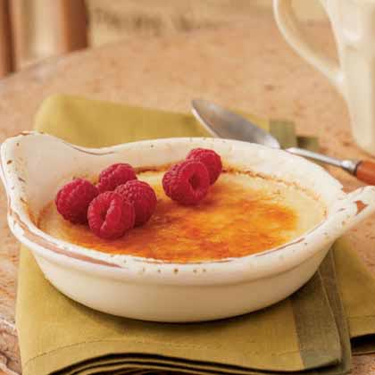 Brûlée: Honey Créme Brûlée with Raspberries RecipeAny time a recipe requires the use of a kitchen blow torch, the result is guaranteed to be good. Make this dessert the night before, then spoon sugar over top of each custard. Move the torch evenly over the top of the custards until the sugar is completely melted and caramelized. The crisp sugar coating is the perfect complement to the creamy treat waiting below.