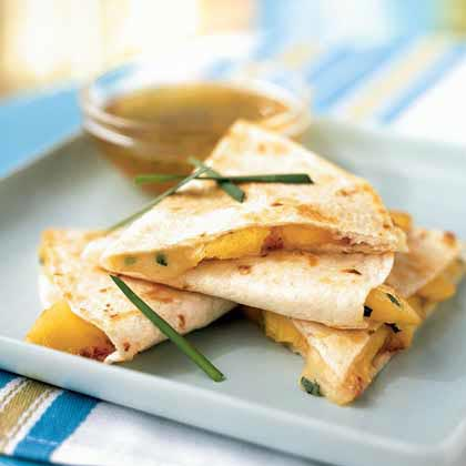 <p>Peach and Brie Quesadillas with Lime-Honey Dipping Sauce</p>