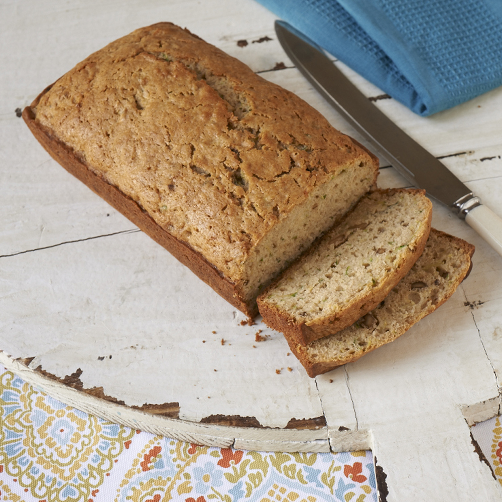 Zucchini Bread RecipeSummer zucchini grows in abundance in the South, so where do we put it all? It goes into sweet breads, of course! You'll admire the little flecks of green in this moist, tender bread.