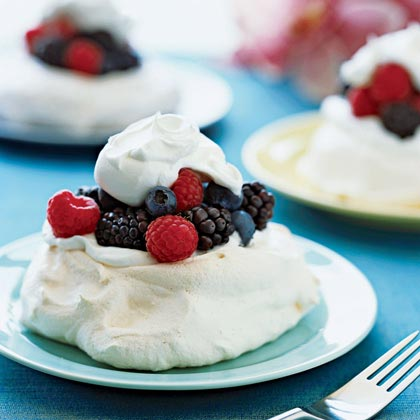 Use whatever type of berries you have on hand for this impressive dessert.Berry Meringues Recipe