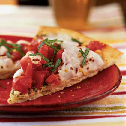 <p>Garden Tomato and Basil Pesto Pizza</p>