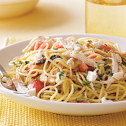 Speedy Spaghetti with Chicken and Fresh Tomato RecipeInstead of a long-simmering tomato sauce, this quick spaghetti dish is tossed with a savory mixture of chopped chicken and fresh tomato and topped with crumbled goat cheese and fresh basil.