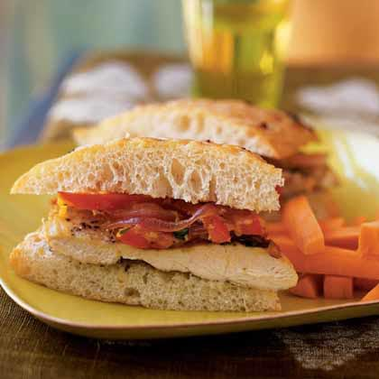 Chicken Focaccia Sandwiches RecipeTop sliced chicken with onion, bell pepper and cheese, and serve on focaccia bread for a quick and easy main dish sandwich.
