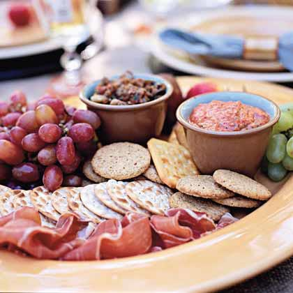 Antipasto Plate RecipeA creamy red bell pepper dip and sweet-savory caponata spread are paired with thinly sliced prosciutto from the deli and purchased crackers for an easy antipasto plate. Add fresh fruit and use an assortment of crackers, if you prefer. Both the dip and the spread can be made and refrigerated up to a day in advance; serve them chilled or at room temperature.