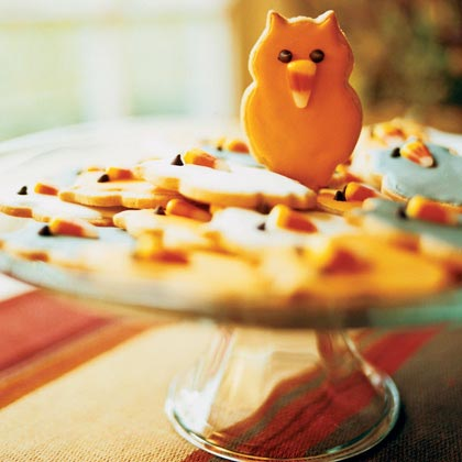 Owl Cookies                            RecipeTrace an owl-shaped pattern on heavy paper or lightweight cardboard, or use cookie cutters in any shape. Then decorate with candy corn and mini chocolate chips.