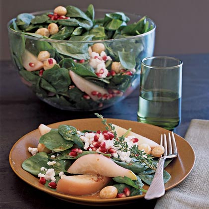 Poached Pear, Macadamia, and Spinach Salad with Goat CheeseRecipe