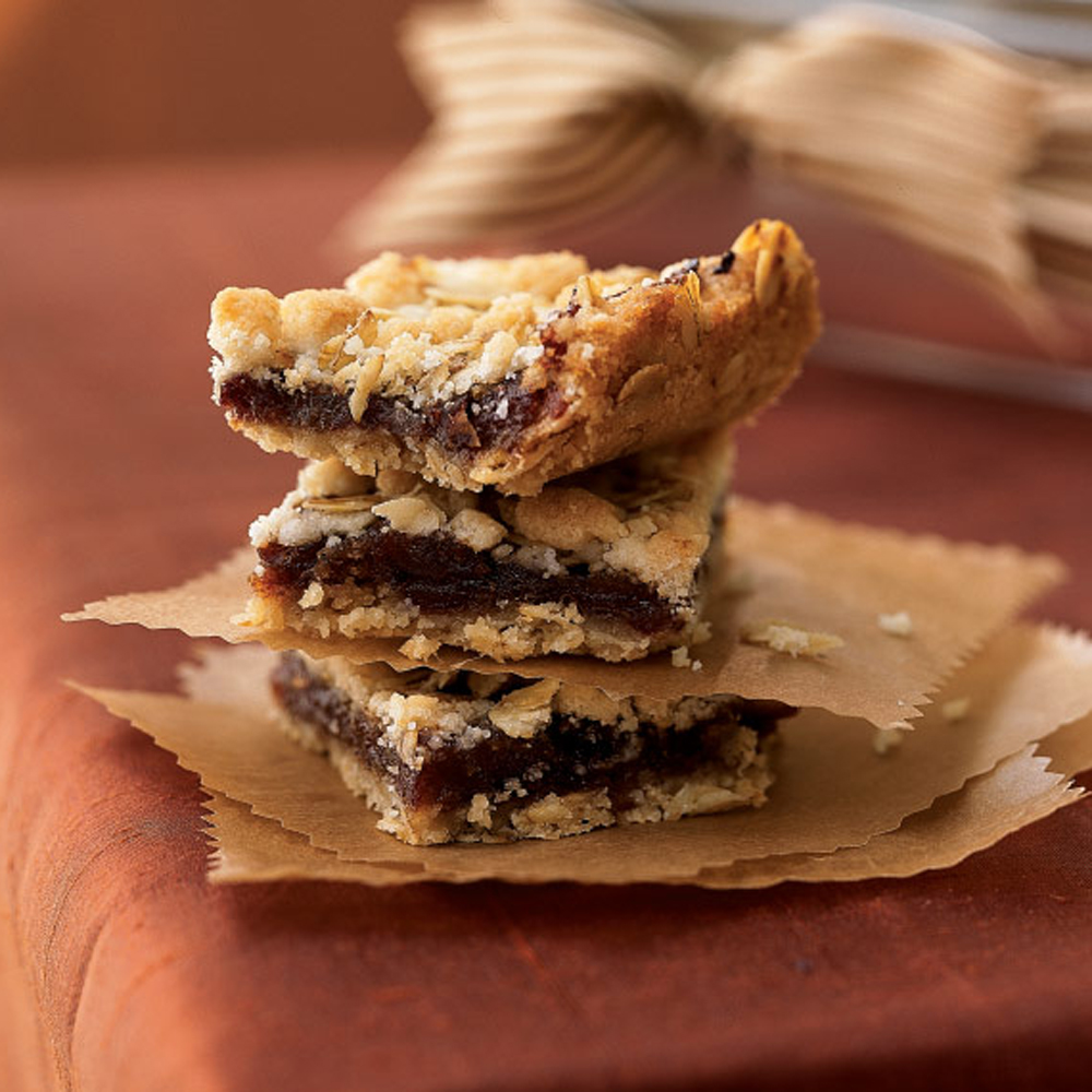Maple-Date Bars RecipeTwo layers of crumbly oatmeal topping sandwich a layer of sweet dates in these super moist bars.