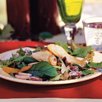 Black Pepper-Chèvre Pastries on Mixed Winter Greens With Cranberry-Port Vinaigrette and Candied Pecans