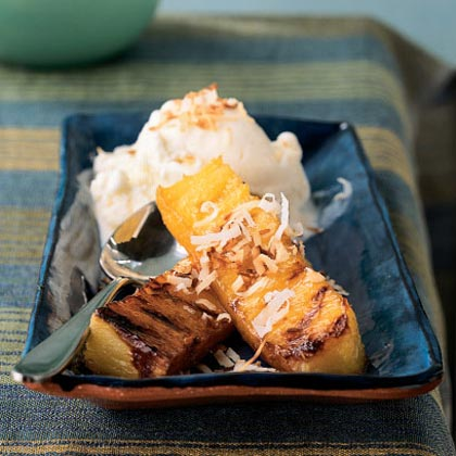 "Rum-Spiked Grilled Pineapple with Toasted Coconut Recipe""This is an excellent light dessert, perfect for serving to company since it has an impressive presentation,"" raves reviewer Cookinnotwritin."