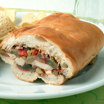 Muffulettas are one of the signature sandwiches of New Orleans, and this chicken version is considerably lower in fat than the traditional ones packed with ham and salami.Chicken Muffuletta Recipe