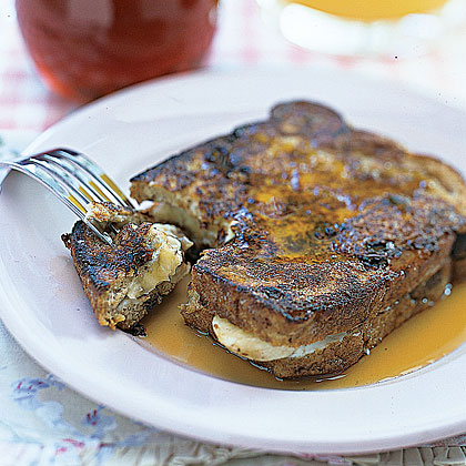 Banana-Stuffed French Toast RecipeGet a serving of fruit in with your sticky-sweet breakfast by layering cinnamon-raisin bread with thinly sliced bananas. A dose of warm maple syrup rounds out the weekend-friendly dish.