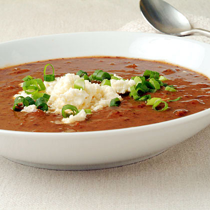 Pumpkin-Black Bean Soup RecipeThis Caribbean-inspired soup combines pumpkin, black beans, tomatoes, and sherry. It's topped with a tangy shower of queso fresco. Use vegetable broth to make this a meatless meal.