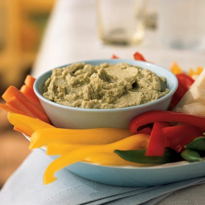 Edamame Dip RecipeSimilar to hummus, but with fewer calories and fat grams, this dip packs a fiber-and-protein punch from soy beans and cannellini beans. It's an ideal treat for the mid-day munchies because it is low in fat and has only 61 calories per serving.