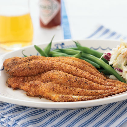 The bacon drippings used to cook the catfish lend this southern family favorite authentic flavor. Use the bacon in the coleslaw, or reserve for another use.Watch the VideoCornmeal-Crusted Catfish Recipe