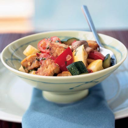 Tempeh Ratatouille RecipeTempeh is a soy cake that's made by fermenting and pressing cooked soybeans. Nutty flavored and chewy, tempeh takes the place of eggplant in this Provencal-style dish featuring tomatoes, squash, onion, garlic and olive oil. Because of the addition of tempeh, this ratatouille is higher in protein than a traditional version and can be served as the main dish.