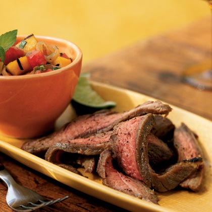 Flank Steak with Grilled Mango and Watermelon Chutney RecipeAfter you grill the flank steak, grill mango slices to add to the  refreshing watermelon salsa topping.