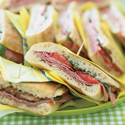 Pressed Mediterranean Sandwiches RecipePair salami and ciabatta bread with fresh tomatoes and basil for a flavorful pressed sandwich.