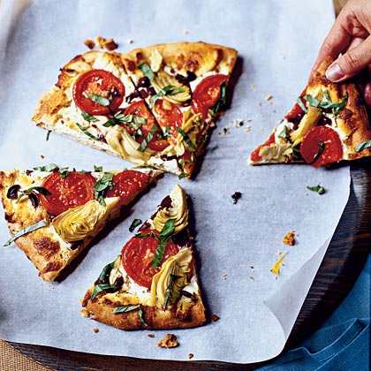 Mediterranean Pizza RecipeThere is nothing better than a crispy pizza topped with bubbly cheese and piled high with toppings. This Mediterranean-style pie is fun to make and healthy too!