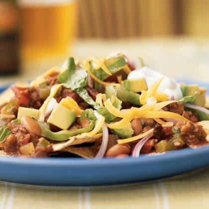 Vegetarian Chipotle Nachos RecipeMeatless soy crumbles are an easy replacement for ground beef in Tex-Mex dishes like nachos, tacos, and burritos. Chipotle chiles in adobo sauce add a rich smokiness to these main dish nachos.