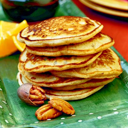 Pecan Pancakes RecipeA sprinkle of cinnamon and the addition of toasted pecans to the batter make these thick and hearty pancakes an extra-special breakfast treat.
