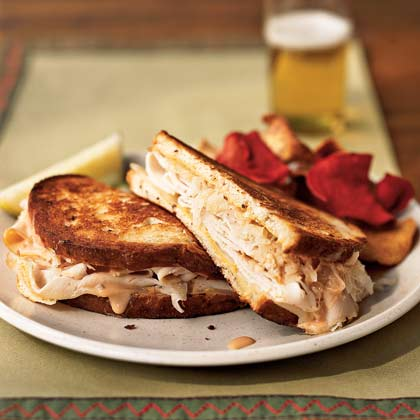 Smoked turkey stands in for corned beef in this lightened variation of a deli favorite. Serve with a pickle wedge and chips.Turkey Reuben Sandwiches Recipe