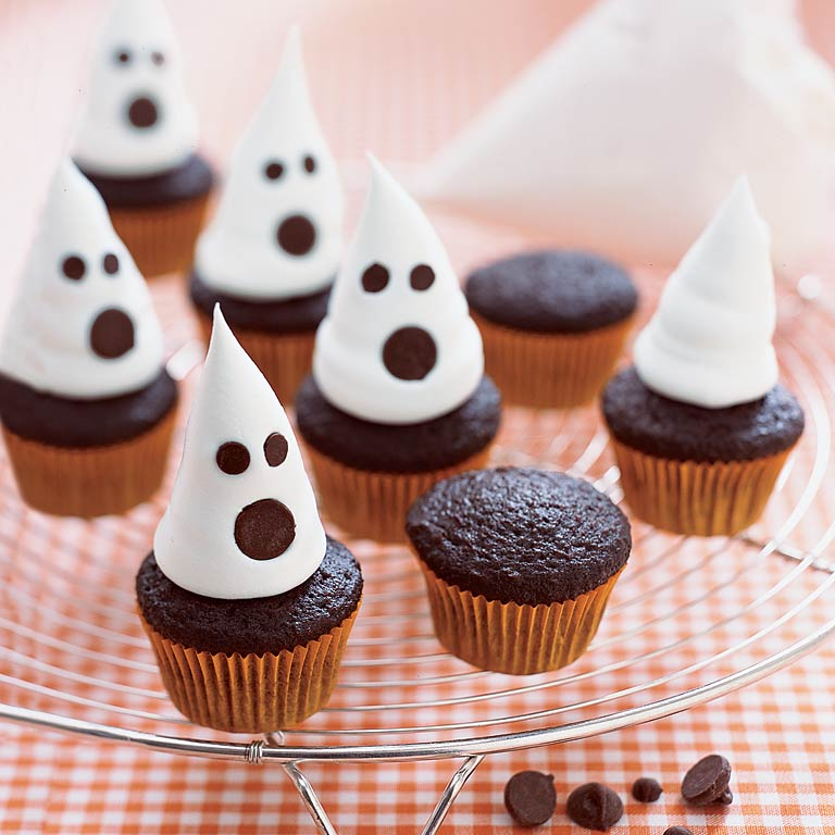 Mini Ghost Cupcakes                            RecipeDecorate mini chocolate cupcakes for the perfectHalloween treats by topping them with whipped topping in the shape of spookyghosts and chocolate chips for their ghastly expressions. These cupcakes are perfectly portable and great to bring along to a your next Halloween bash!