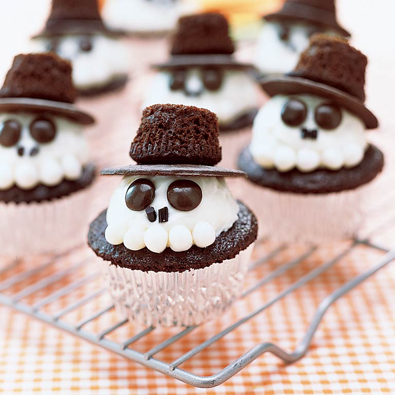 Skeleton Cupcakes RecipeGive your chocolate cupcakes a scary skeleton makeover! Frost Chocolate Cupcakes with a dollop of homemade white frosting, then top with a chocolate wafer and upside down mini chocolate cupcake. Add brown M&Ms for eyes and black licorice for a nose. White jelly beans transform this skeleton into a tasty, toothy treat.