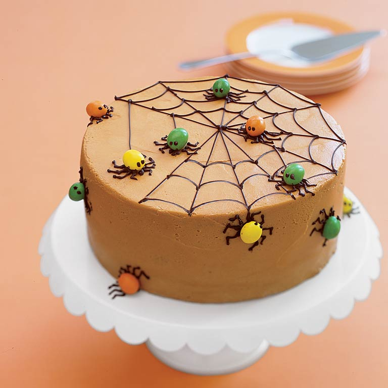 Even with the spiders you'll never be able to resist the call of this fragrant spice cake. It's decorated for Halloween, but you're sure to enjoy it year around.Spiderweb Spice Cake Recipe