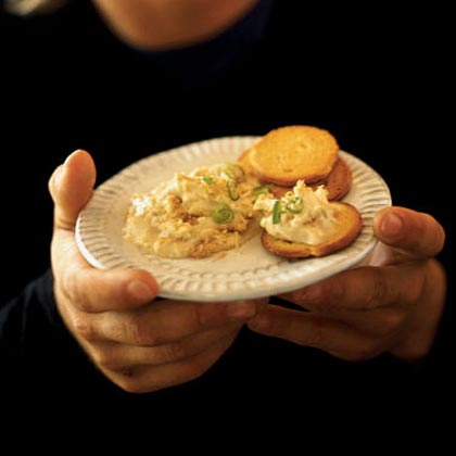 Hot Crab Dip RecipeFor those special occasions when you need to impress, splurge on lump crab meat and whip up this light spread that fashions its creamy texture from a combination of fat free cottage cheese and light cream cheese.
