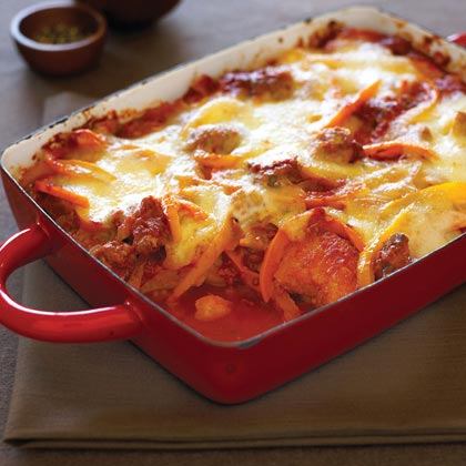 Baked Polenta with Sausage & Tomato-Pepper Sauce Recipe | MyRecipes