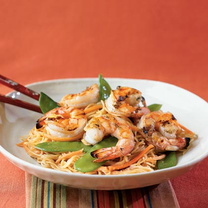 Orange-Sesame Noodles with Grilled Shrimp RecipeA generous splash of fresh-squeezed orange juice gives a lift to traditional peanut soba noodle salad. Leave off the shrimp if you want to make this vegetarian. Or top with grilled chicken strips, pork, or steak for another variation.