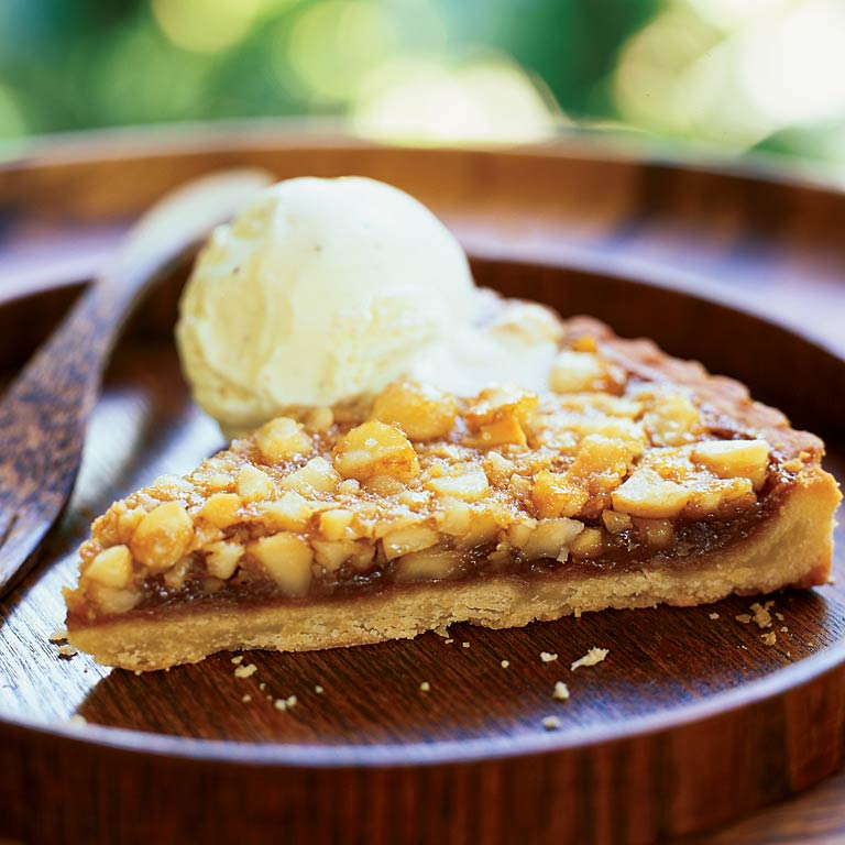 Top this simple macadamia nut tart with a heaping scoop of vanilla bean ice cream for a smooth contrast to the tart's crunchy sweetness.Macadamia Nut Tart Recipe